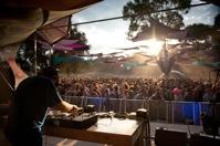 A DJ on the decks entertaining a crowd